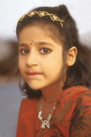 India - young girl wearing red