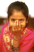 Young girl form India with gold braid