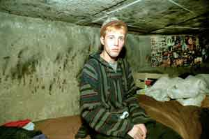 Young boy living in the underground of Bucharest Romania